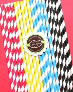 Stripe Paper Straws - Super Hero Party in Red, Yellow, Bright Blue and Black with Printable DIY Flag Toppers (30 count). $5.00, via Etsy.