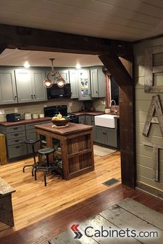 Cute rustic kitchen featuring Deerfield Shaker II Maple Creek Stone cabinets…