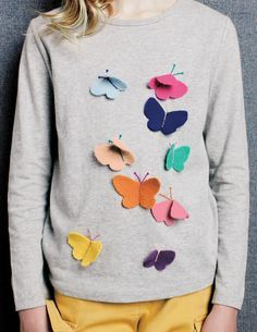 Sew butterflies on a girl's shirt--simple, cute, and easy enough for her to help