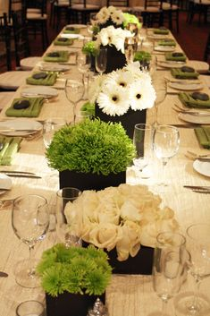 Table Flower Arrangements | the black of the floral containers really accentuated the greens and
