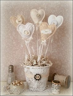 heart picks from fabric and lace scraps put in a painted peat pot.