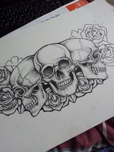 minus the center skull, two outside skulls facing each other, and a few more red roses, and this is almost exactly what i want for my chest piece!!