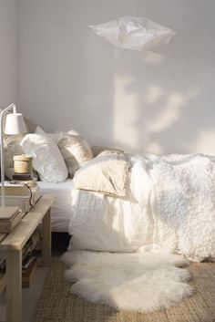 Warm sunlight in a white bedroom.