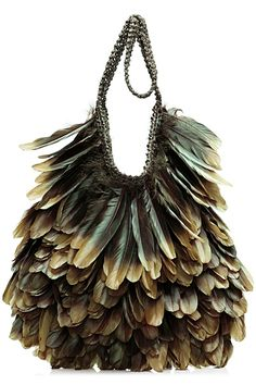 Tom Ford - Leather and Feathers Bag.  That man is incapable of making anything that isn't gorgeous, sexy, want-it-right-now.