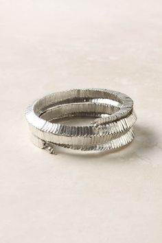 shiny metal coil for your wrist. like a modern cuff link.