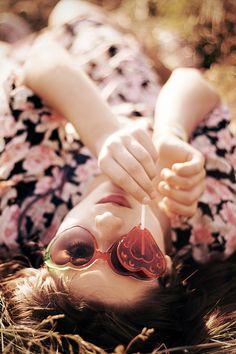 Sunglasses and lollipop portrait idea