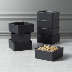 Shop Bento Mini Black Square Bowl Set of 8. Go-to, go with everything dinnerware turns a corner in modern matte black stoneware. Deep square bowls think outside the box. bento matte black mini bowls set of eight is a CB2 exclusive.