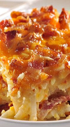 Hearty Potato Bacon Casserole ~ features tender hash browns and succulent bacon pieces. It's a perfect crowd pleaser for brunch or any meal.(Potato Recipes For A Crowd) What's For Breakfast, Breakfast Dishes, Breakfast Recipes, Breakfast Potatoes, Morning Breakfast, Potato Dishes, Food Dishes, Side Dishes, Potato Meals