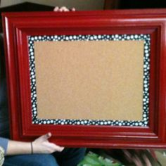 Thrift store frame, spray paint, cork board and ribbon. Easy!