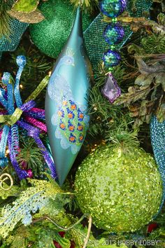 With it's bold jewel toned hues of emerald green and turquoise, the peacock is a symbol of renewal and immortality.