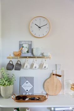 Modern white and brass bungalow kitchen: http://www.stylemepretty.com/living/2016/09/21/crafting-a-dream-bungalow-in-venice-beach/ Photography: Amy Bartlam - http://www.amybartlam.com/