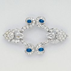 Diamond, Sapphire and Platinum Brooch   Set throughout with diamonds altogether weighing approxiamtely 5.70 carats