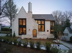 Modern Farmhouse house exterior ideas with white brick. Love the lines of the front roof and how it intersects with the main roof line. Curb appeal ideas, house exterior inspo, white houses with gray roofs Future House, My House, Tudor House, Cottage House, Tudor Cottage, Cottage Style, Grand House, French Cottage, Cozy Cottage