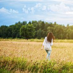i love how she looks like she is walking away in a field