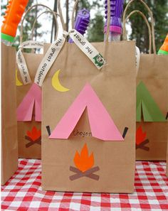 Brown Bag Favors w/ Campout theme. Dollar store flashlights, glow sticks, s'mores pack...