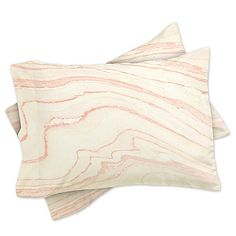 Dainty and delicate, the DENY Designs Rebecca Allen Blush Marble Pillow Shams Set will add a soft elegance to your bedroom style. The luxuriously soft pillow shams feature a blush pink and white marble-inspired design.