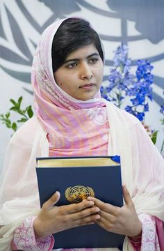 In this photo, Malala, who visited the United Nations Headquarters on 12 July, holds a copy of the UN Charter. Credit: Eskinder Debebe