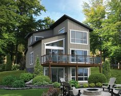Designed for relaxation, this lovely cottage offers a spectacular view of the surrounding nature thanks to an elevated terrace and several huge windows. The home is 24 feet wide by 30 feet deep and provides 1,188 square feet of living space. <br/> With 696 square feet of living space, the open area on the ground floor includes a living room with a cathedral ceiling whose height varies from 10 to 14 feet, where you can relax by the gas fireplace, a kitchen with an island, a dining ...