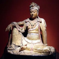 """Bodhisattva, Song Dynasty.  Shanghai Museum.  This image, of gilded and painted wood, shows a bodhisattva sitting in """"Royal Ease."""" The figure can be compared to the celebrated Song Dynasty Guanyin at the Nelson-Atkins Museum in Kansas City."""