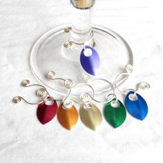 wire wine glass charms silver with rainbow scales. made in ireland. by terramor on Etsy Wine Glass Charms, Ireland, Wire, Rainbow, Charmed, Drop Earrings, Unique Jewelry, Handmade Gifts, Silver