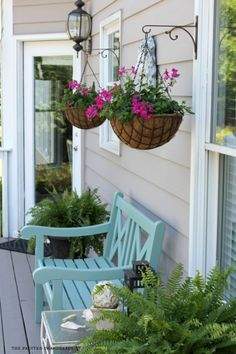 Back porch summer deck makeover - great location for hanging plants on the front deck. So inviting. | The Painted Chandelier Blog
