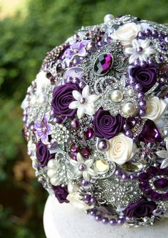 Allergic to flowers? An intricate brooch bouquet is perfect for your day and can also incorporate your wedding day colors. #purpleweddings #weddingideas