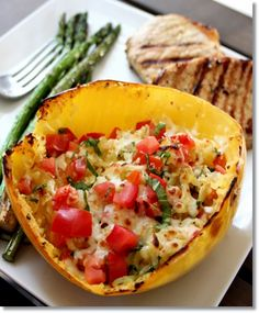 Baked Margherita Spaghetti Squash Christi.....I added chopped chicken. Very yummy and easy. Might remove the squash before add ins and cheese