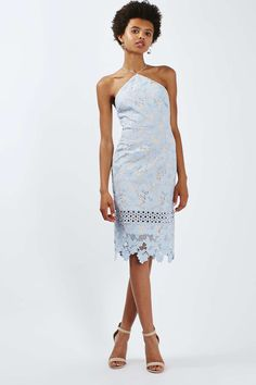 A slinky silhouette and delicate halterneck straps make this midi dress a perfect addition to seasonal styling.