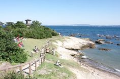 Cape Tomyo (燈明崎, toumyozaki) is the cape in Uraga, Kanagawa. This is where people collect pottery shard and beach glass.  In the Edo Period, there is the Japanese style lighthouse for over 220 years. From over 7.2 km of distance, ship could see this light. Currently, the base rock are still the original shape and the lighthouse was rebuilt in 1988. There is beach in this cape. You can enjoy great view of Tokyo Bay.  Tourist Info. There is parking and restroom. Parking is 1,000 yen in summer.