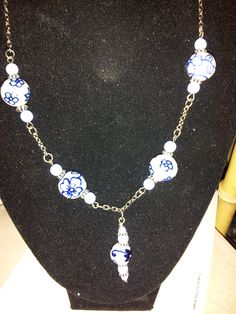 "16"" necklace of porcelain beads of blue and white (like the old dinnerware pattern) --comes with matching earrings"