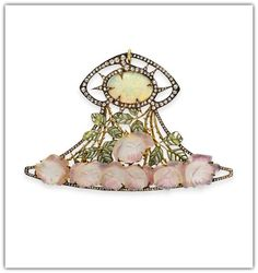 RENE LALIQUE | AN ART NOUVEAU OPAL, DIAMOND, ENAMEL AND GLASS 'ROSE' PENDANT. Designed as a rose-cut diamond openwork plaque, centering upon an oval cabochon opal, within a rose-cut diamond surround, to the green plique-à-jour enamel and gold leaves extending a carved pink glass rose cascade, mounted in gold, circa 1900.