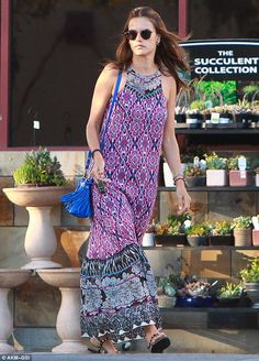 Keeping it casual: Alessandra Ambrosio sported a pretty pink and purple printed halterneck...