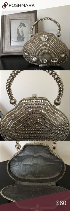 """Frame style all metal purse This unique frame purse is hand made with all metal material. Never  used, light weight with grey, silver lining.   8"""" wide and 6"""" tall without handle and hangs 9 1/2"""" all together. Bags Mini Bags"""