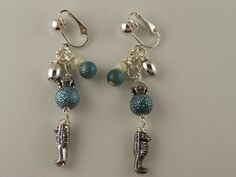 Pretty fish dangle clip on earrings from www.thecliponearringstore.com