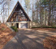 A frame cabin with Garage Base + Overhang Porch