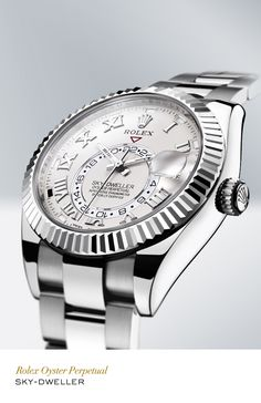 Rolex Sky-Dweller 42 mm in 18 ct white gold with a fluted bezel, ivory dial and Oyster bracelet. #RolexOfficial