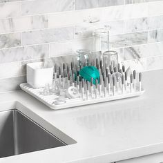 Dry more than just bottles on OXO Tot's Bottle Drying Rack. From bottle nipples, to breast pump parts, pacifers and more, the rack is designed on elevated feet and has raised ribs to keep items away from water that collects on the bottom. Baby Bottle Organization, Baby Bottle Storage, Organization Ideas, Storage Ideas, Best Baby Shower Gifts, Baby List, Grey Bedding, Baby Needs, Baby Store