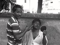 https://flic.kr/p/pkoqXg   The Street Barbers  Of Mumbai   I dont know why I began shooting barbers , religious tonsure or Mundan..perhaps because  my grandkids were going bald during Akika that made me document their first step and tryst with barbers .  I have  many barber friends and I knew Mr Hakim the Taj when I  worked at Burlingtons I knew Anand at Centaur and many other hairdressers ,even my best pal Cory Walia had shaped my hair making me look like his nephew Rahul Roy ,,  I had deads and extensions  thanks to an English lay Diana she was no 1 in dreads I met her through Al The Tattoo Artist.  To a cut long story short I got more interested in shooting barbers at Banganga during the Hindu festival of Pitru Paksha and I have a large collection of barber pictures at my Flickr timeline .  I shot a husband and wife undergoing religious tonsure at Haji Malang to fulfill a Mannat or wish.. through the wishes of the Holy Saint they had got married and here they came and religiously went bald ..  I shot barbers at the banks of the Ganges at Allahabad , barbers at Latur , barbers at Lucknow and the various dargahs I visited ,, now I have started shooting videos of these selfless street barbers of Bandra.