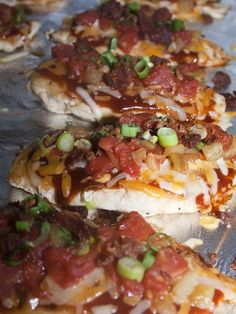 Monterey Chicken -4 boneless, skinless chicken breasts, 1/4 cup bar-b-que sauce 1/4 cup real bacon bits, 1 cup cheddar/monterey jack cheese, 1 14 oz. can diced tomatoes, drained 1 5 oz can fire roasted green chiles, sliced green onions, salt & pepper 1. Cook chicken until no longer pink. Place on baking sheet covered with foil. 2. Combine tomatoes and chiles in a bowl. Top each chicken breast with the items listed above. Place in oven and bake until cheese is melted (about 5 minutes).