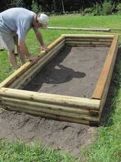 Backyard raised bed using landscape timbers.  We made our vegetable garden out of these timbers as the garden is on a hilly area.  Ours is much bigger...but a great choice in material for the garden.