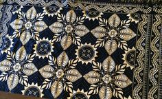"""The date on this double-weave """"fancy"""" coverlet is unknown, but it hung in the childhood home of Robert Oliver, born in 1882. He served as a veterenarian during WWI, caring for the horses and mules. He later went to Cuba with Teddy Roosevelt and..."""