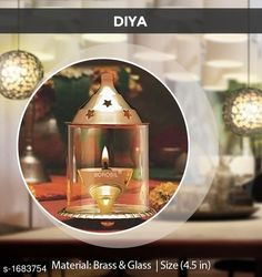 Festive Diyas & Candles Traditional Brass and Glass Diya  *Material* Brass & Glass  *Size* 4.5 in  *Description* It Has 1 Piece Of Diya  *Sizes Available* Free Size *   Catalog Rating: ★4 (1849)  Catalog Name: Traditional Brass and Glass Diyas CatalogID_219690 C128-SC1604 Code: 453-1683754-