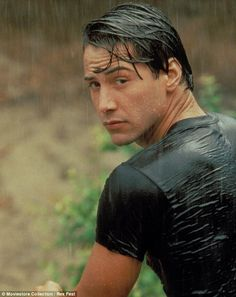 The good old days: In 1991s Point Break, Keanu particularly handsome and wet - hehe