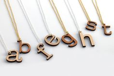 Love. Kind of want to get several and spell out a word. :: Custom Initial Necklace by HavokDesigns
