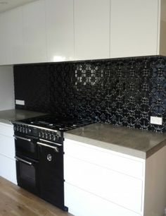 Stunning gloss black kitchen splashback. These Fleur panels were powdercoated to give them this hard wearing finish. 600mm x 1800mm and 900mm x 1800mm panels available in NZ at www.stamp.net.nz