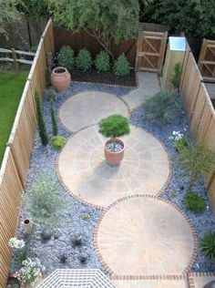 Love the symmetry and natural flow of this paved garden for small or side yards.