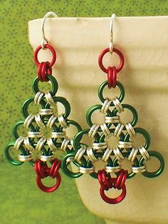 """Make a couple of stunning tannenbaum earrings to wear during the holiday season!   This lovely and simple Christmas tree earrings kit includes everything you need to make 2 delightful and cheerful earrings. It includes custom handmade rings in sizes that make the tree hang gracefully with a weave to make it display more elegantly. Also included are enough jump rings and supplies to make 2 Christmas tree pendants measuring just over 1 1/2""""L, some extras in case you make a mistake, ear wires ..."""