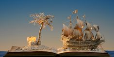 Su Blackwell - Treasure Island, 2013, created using reclaimed materials...Su Blackwell's textile training plays a vital role in the creation of her exquisite book sculptures. As noted by Justin Croft (Antiquarian Bookseller) 'Each letter is like a stitch; it's as if she's weaving with words'.
