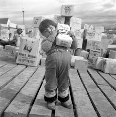 A young girl carrying a bag of sugar by Rosemary Gilliat 1960 Frobisher Bay, N.T (Iqaluit, Nunavut) Library and Archives Canada Vintage Cuba, Inuit People, Hunting Party, Little Girl Names, Inuit Art, Animal Bones, Dreams Do Come True, Canada, Male Poses