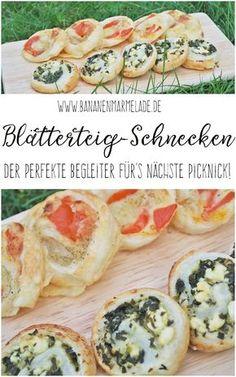 Heute gibt es das Rezept für einen deftigen Picknicks-Beitrag: kleine Blätterteigschnecken, einmal mit Tomate-Mozzarella und einmal mit Spinat-Feta.